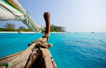 dhow-sailing-on-ocean-and-mnemba-island